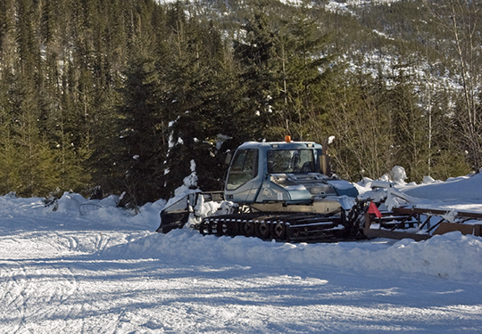 A trail groomer used to pack snowmobile trails from valley bottoms up into subalpine winter caribou habitat