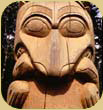 Totem pole depicting bear with salmon.